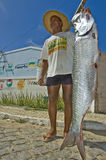 Happy fisherman. Holding a sea bass in Brasil Royalty Free Stock Photos