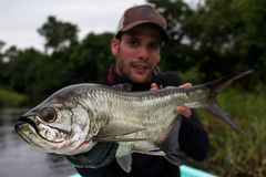 Happy Fisherman holding a Tarpon royalty free stock image
