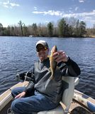 Happy Fisherman holding up a caught Walleye Royalty Free Stock Photos