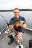 Happy fisherman with zander. Fishing trophy Royalty Free Stock Images