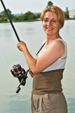 Happy fisherwoman Stock Images