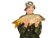 Happy fisherwoman with big fish Royalty Free Stock Photo