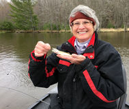 Happy Fisherwoman with a tiny Walleye Stock Photography