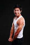 Happy fit asian man posing Royalty Free Stock Images