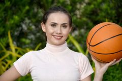 Happy Fit Asian Person With Basketball. An attractive and asian person stock image
