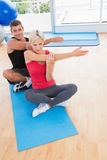 Happy fit couple working on exercise mat Royalty Free Stock Photo