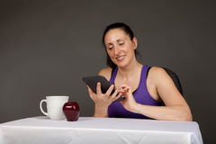 Happy fit girl with an e-reader Stock Photos
