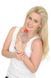 Happy Fit Healthy Natural Young Blonde Woman Holding a Bottle of Mineral Water Royalty Free Stock Image