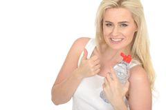 Happy Fit Healthy Positive Young Blonde Woman Holding a Bottle of Mineral Water Stock Photo