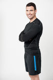 Happy fit male with arms crossed Royalty Free Stock Image