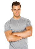 Happy fit male posing over white background Royalty Free Stock Photography