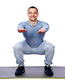 Happy fit man doing squats Royalty Free Stock Images