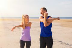 Man and woman stretching before workout stock photography