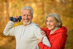 Happy fit senior couple exercising Stock Image