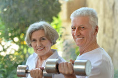 Happy fit senior couple exercising Stock Images