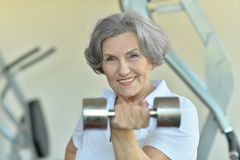 Happy fit senior woman exercising Stock Images