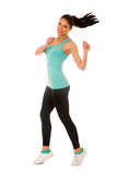 Happy fit and slim woman dancing and jumping isolated over white Stock Photo