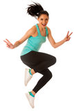Happy fit and slim woman dancing and jumping isolated over white Stock Photography