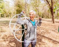 Happy Fit Successful Senior Woman Raised Arms At Outdoor Gym. Shows Strength And Winning. Activity Old People Fitness Lifestyle stock image