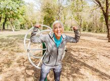 Happy Fit Successful Senior Woman Raised Arms At Outdoor Gym. Shows Strength And Winning. Activity Old People Fitness Lifestyle stock photos