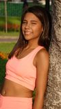Happy Fit Thin Girl. Attractive young teen hispanic girl Stock Photo