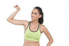 Happy fit woman. A happy fit woman flexing, photographed in studio Stock Image