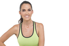 Happy fit woman. A tight shot of a happy woman wearing athletic wear. Photogrpahed in studio Stock Photo