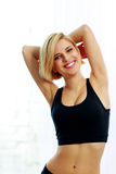 Happy fit woman in black sportswear Royalty Free Stock Photos