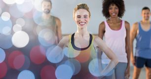 Happy fit woman with friends in gym Stock Images