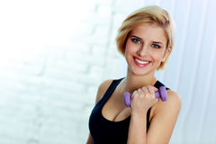 Happy fit woman holding dumbbel Royalty Free Stock Images