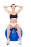 Happy fit woman working out with exercise ball Royalty Free Stock Photos