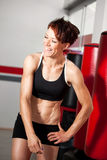 Happy fit woman after workout smiling Royalty Free Stock Image
