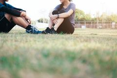 Young couple relaxing after physical training. Happy fit young couple relaxing after physical training session Royalty Free Stock Photography