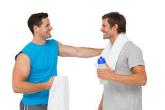 Happy fit young men with water bottle and towels Stock Images