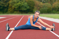 Free Happy Fit Young Woman Doing Stretching Exercises Royalty Free Stock Image - 77530826