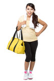 Happy fit young woman with gym bag standing ready for fitness ex Royalty Free Stock Image