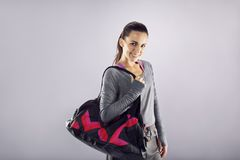 Happy fit young woman with gym bag Royalty Free Stock Images