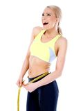 Happy Fit Young Woman Measuring Waist Line Royalty Free Stock Photos
