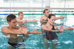 Happy fitness class doing aqua aerobics Royalty Free Stock Photos