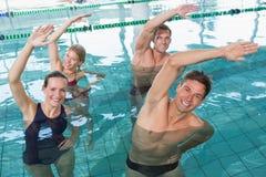 Happy fitness class doing aqua aerobics Stock Photos