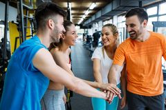 Happy fitness class giving high-five after completing exercise session stock photography