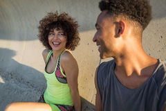 Happy fitness couple in sportswear laughing Stock Photos