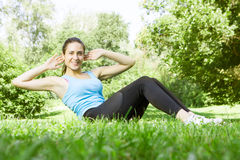Happy fitness girl doing exercise Royalty Free Stock Image