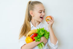 Happy fitness girl holding vegetables isolated Stock Photos