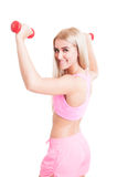 Happy fitness girl lifting weights Royalty Free Stock Photo