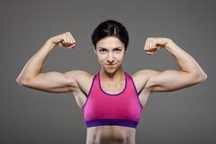 Happy muscular fitness girl Royalty Free Stock Image
