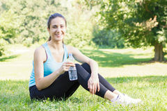 Happy fitness girl relaxing after exercising Stock Photography