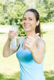 Happy fitness girl relaxing after exercising Royalty Free Stock Photography