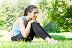 Happy fitness girl relaxing Stock Photography
