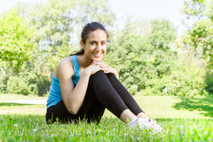 Happy fitness girl relaxing Stock Images